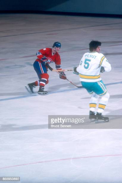 Steve Shutt of the Montreal Canadiens takes the shot as George Pesut of the California Golden Seals goes for the block during an NHL game on March 19...