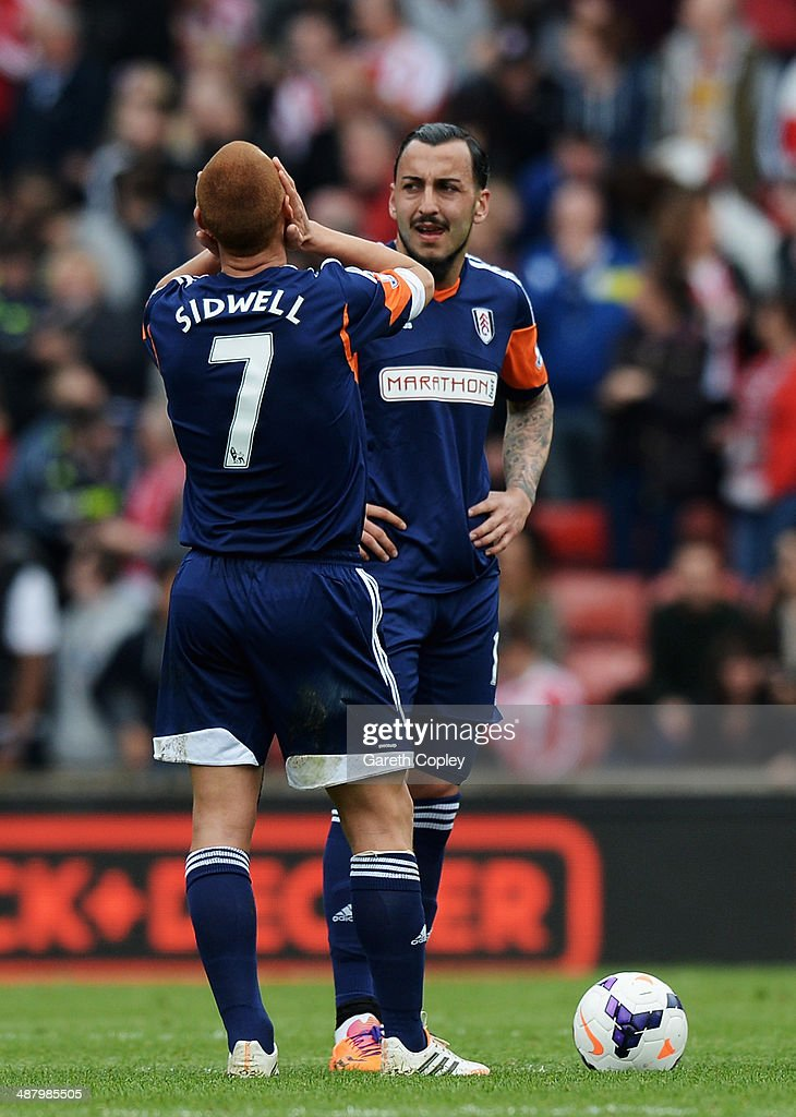 <a gi-track='captionPersonalityLinkClicked' href=/galleries/search?phrase=Steve+Sidwell&family=editorial&specificpeople=661187 ng-click='$event.stopPropagation()'>Steve Sidwell</a> and Konstantinos Mitroglou of Fulham react as their side concedes a third goal during the Barclays Premier League match between Stoke City and Fulham at the Britannia Stadium on May 3, 2014 in Stoke on Trent, England.