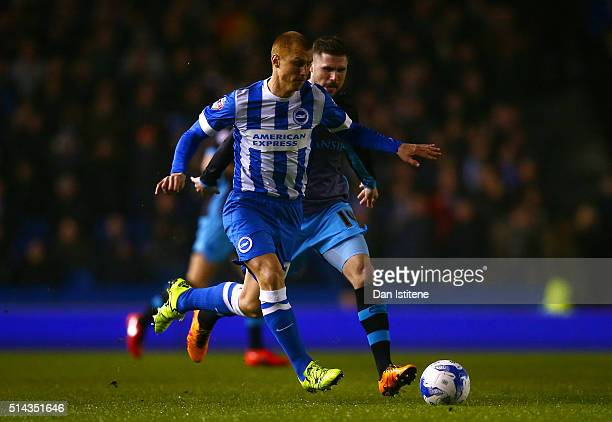Steve Sidwell of Brighton and Hove Albion runs with the ball under pressure from Gary Hooper of Sheffield Wednesday during the Sky Bet Championship...