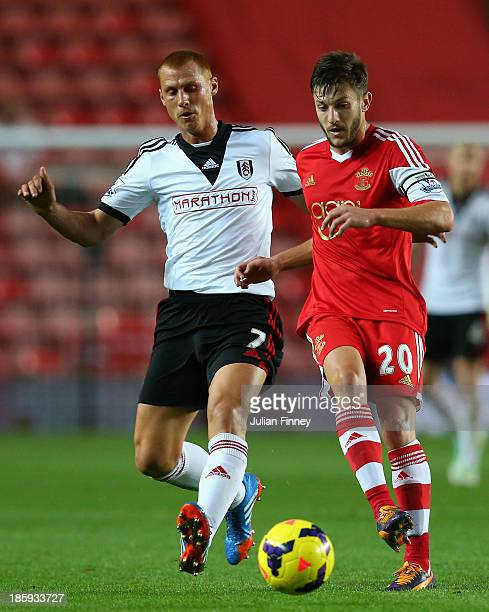 Steve Sidwell of Fulham and Adam Lallana of Southampton battle for the ball during the Barclays Premier League match between Southampton and Fulham...