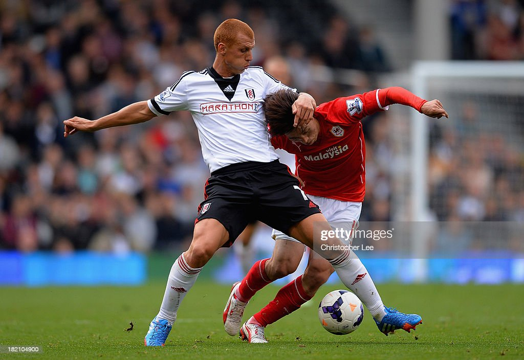 <a gi-track='captionPersonalityLinkClicked' href=/galleries/search?phrase=Steve+Sidwell&family=editorial&specificpeople=661187 ng-click='$event.stopPropagation()'>Steve Sidwell</a> of Fulham battles with Bo-Kyung Kim of Cardiff during the Barclays Premier League match between Fulham and Cardiff City at Craven Cottage on September 28, 2013 in London, England.