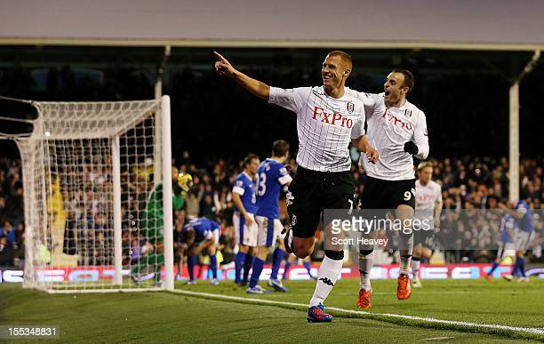 Steve Sidwell of Fulham celebrates after scoring their second goal during the Barclays Premier League match between Fulham and Everton at Craven...