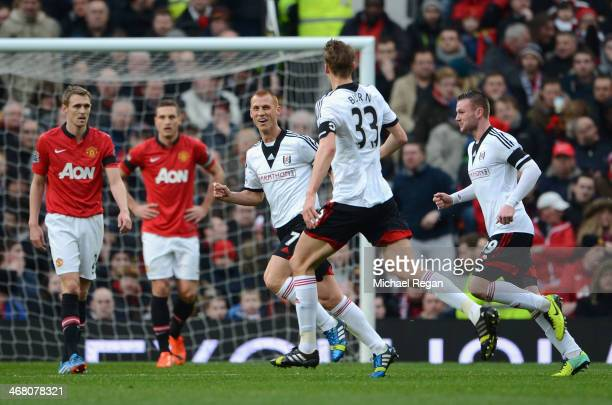 Steve Sidwell of Fulham celebrates scoring the opening goal during the Barclays Premier League match between Manchester United and Fulham at Old...