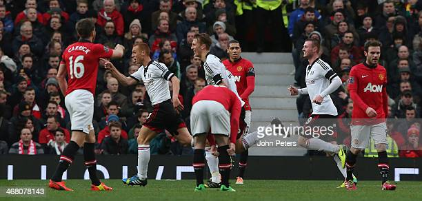Steve Sidwell of Fulham celebrates scoring their first goal during the Barclays Premier League match between Manchester United and Fulham at Old...