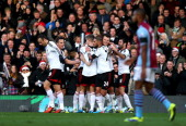 Steve Sidwell of Fulham is congratulated by teammates after scoring the opening goal during the Barclays Premier League match between Fulham and...