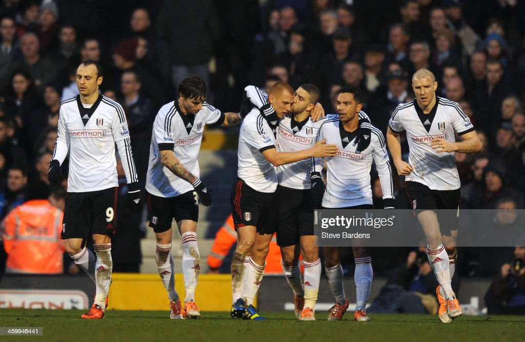 <a gi-track='captionPersonalityLinkClicked' href=/galleries/search?phrase=Steve+Sidwell&family=editorial&specificpeople=661187 ng-click='$event.stopPropagation()'>Steve Sidwell</a> of Fulham is kissed by teammate <a gi-track='captionPersonalityLinkClicked' href=/galleries/search?phrase=Adel+Taarabt&family=editorial&specificpeople=3275547 ng-click='$event.stopPropagation()'>Adel Taarabt</a> after scoring a goal to level the scores at 1-1 during the Barclays Premier League match between Fulham and West Ham United at Craven Cottage on January 1, 2014 in London, England.
