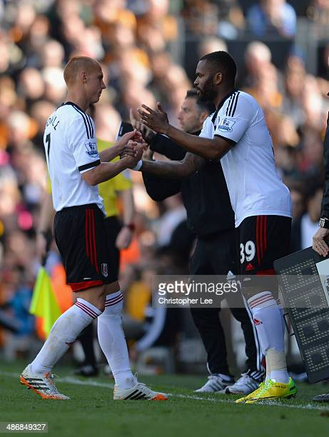 Steve Sidwell of Fulham is substituted by Darren Bent during the Barclays Premier League match bewteen Fulham and Hull City at Craven Cottage on...