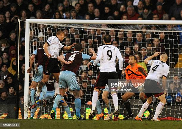 Steve Sidwell of Fulham rises above the West Ham defence to score a goal to level the scores at 11 during the Barclays Premier League match between...