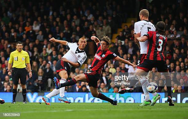 Steve Sidwell of Fulham scores the opening goal during the Barclays Premier League match between Fulham and West Bromwich Albion at Craven Cottage on...