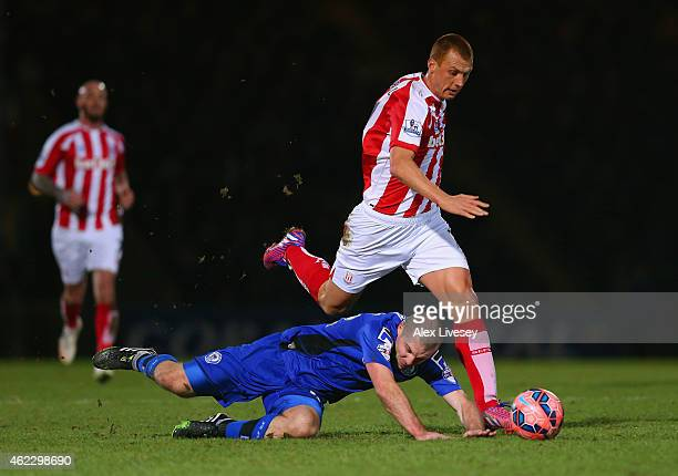Steve Sidwell of Stoke City fouls Stephen Dawson of Rochdale during the FA Cup fourth round match between Rochdale and Stoke City at Spotland Stadium...