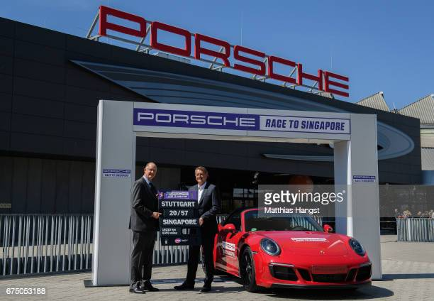 Steve Simon WTA CEO and Chairman and Detlev von Platen Member of the Executive Board Porsche AG present the Porsche Race to Singapore on Day 7 of the...