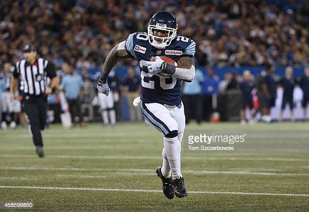 Steve Slaton of the Toronto Argonauts carries the ball during CFL game action against the Ottawa Redblacks on November 7 2014 at Rogers Centre in...