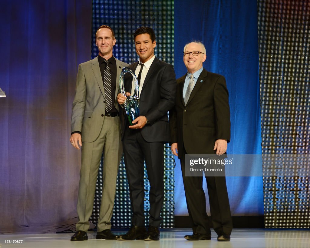 Steve Sleeper (L) and Max Wexler (R) present <a gi-track='captionPersonalityLinkClicked' href=/galleries/search?phrase=Mario+Lopez&family=editorial&specificpeople=235992 ng-click='$event.stopPropagation()'>Mario Lopez</a> (C) with the 'The Beautiful Humanitarian' award at the 2013 North American Hairstyling Awards at Mandalay Bay on July 14, 2013 in Las Vegas, Nevada.