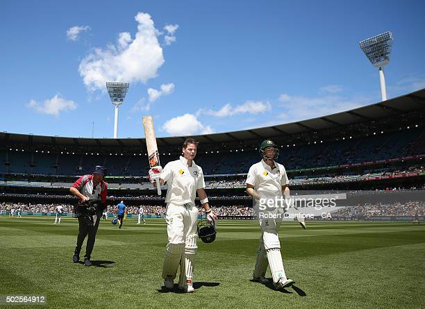 Steve Smith and Adam Voges of Australia acknolwledge the crowd as they walk off the ground after declaring during day two of the Second Test match...