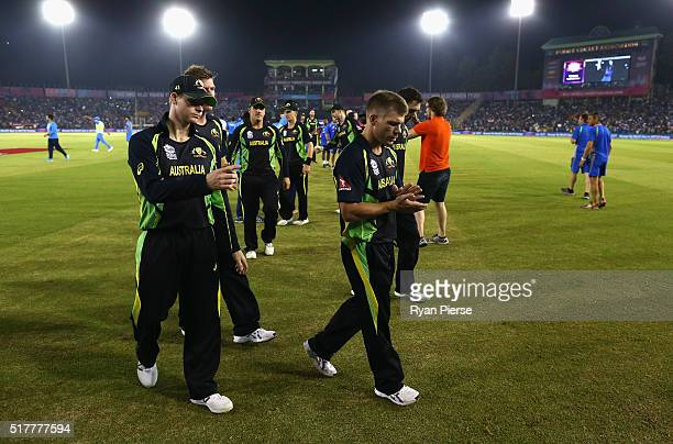 Steve Smith and David Warner of Australia leave the ground after the ICC WT20 India Group 2 match between India and Australia at IS Bindra Stadium on...