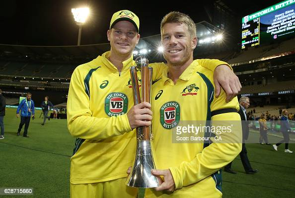 Steve Smith and David Warner of Australia pose with the trophy after winning game three of the One Day International series between Australia and New...
