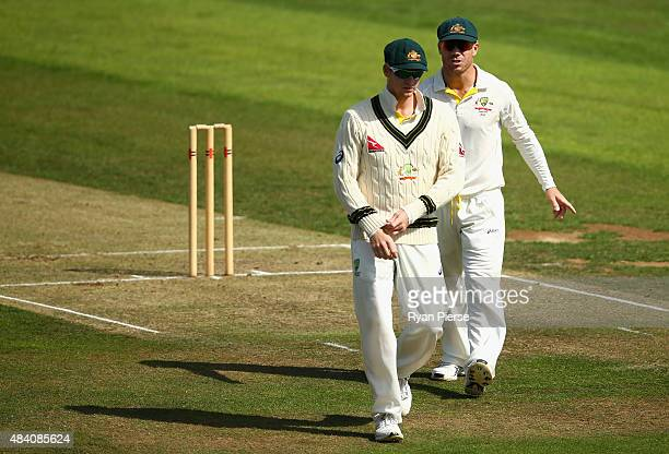 Steve Smith and David Warner of Australia talk during day two of the tour match between Northamptonshire and Australia at The County Ground on August...