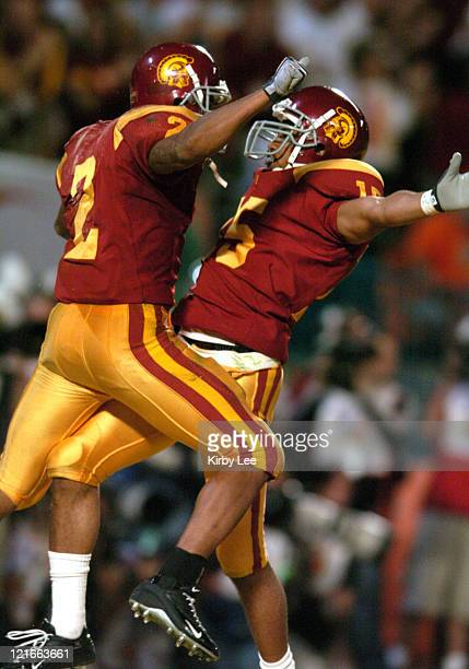 Steve Smith and Jason Mitchell of USC celebrate a touchdown during 5519 victory over Oklahoma in the FedEx Orange Bowl at Pro Player Stadium in Miami...