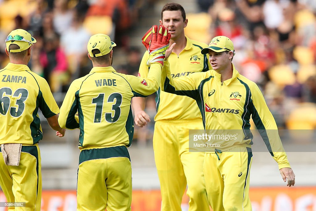 Steve Smith (R) and <a gi-track='captionPersonalityLinkClicked' href=/galleries/search?phrase=Matthew+Wade&family=editorial&specificpeople=724041 ng-click='$event.stopPropagation()'>Matthew Wade</a> (C) of Australia celebrate the wicket of Corey Anderson of New Zealand during game two of the one day international series between New Zealand and Australia at Westpac Stadium on February 6, 2016 in Wellington, New Zealand.