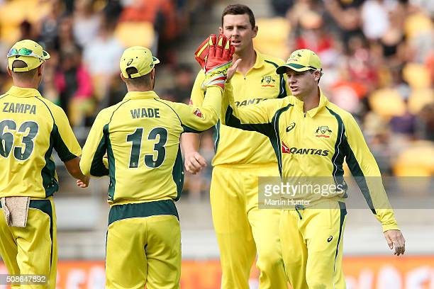 Steve Smith and Matthew Wade of Australia celebrate the wicket of Corey Anderson of New Zealand during game two of the one day international series...