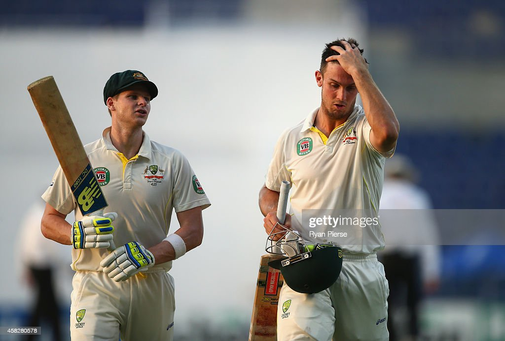Steve Smith and Mitch Marsh of Australia walks from the ground at stumps during Day Four of the Second Test between Pakistan and Australia at Sheikh Zayed Stadium on November 2, 2014 in Abu Dhabi, United Arab Emirates.