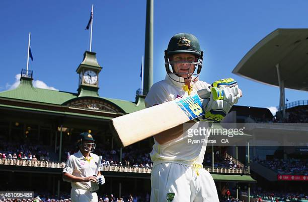 Steve Smith and Shane Watson of Australia walk out to bat during day two of the Fourth Test match between Australia and India at Sydney Cricket...