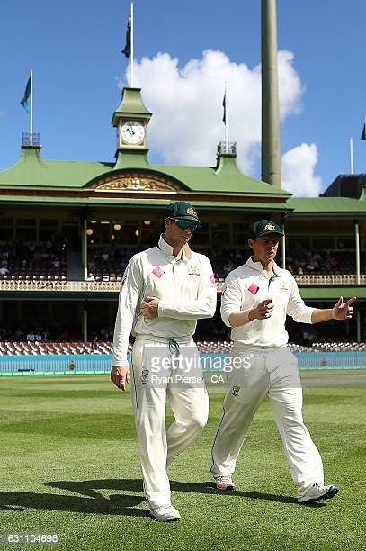 Steve Smith and Steve O'Keefe of Australia walk out to field during day five of the Third Test match between Australia and Pakistan at Sydney Cricket...