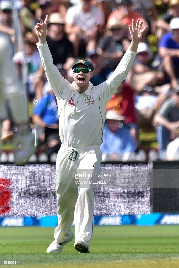 Steve Smith captain of Australia celebrates New Zealand's Brendon McCullum being caught during day one of the first cricket international five-day Test match between New Zealand and Australia at Basin Reserve in Wellington on February 12, 2016. / AFP / Marty Melville