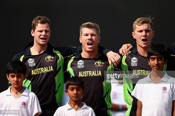Steve Smith David Warner and Adam Zampa of Australia sing the national anthem during the ICC World Twenty20 India 2016 Super 10s Group 2 match...