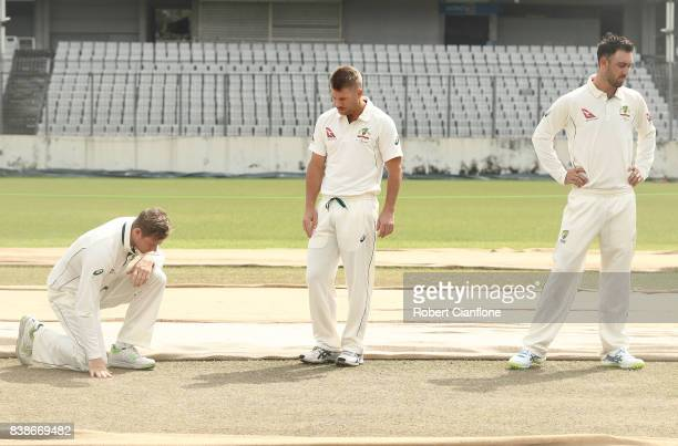 Steve Smith David Warner and Glenn Maxwell of Australia check the pitch before an Australian Test team nets session at SherE Bangla National Cricket...