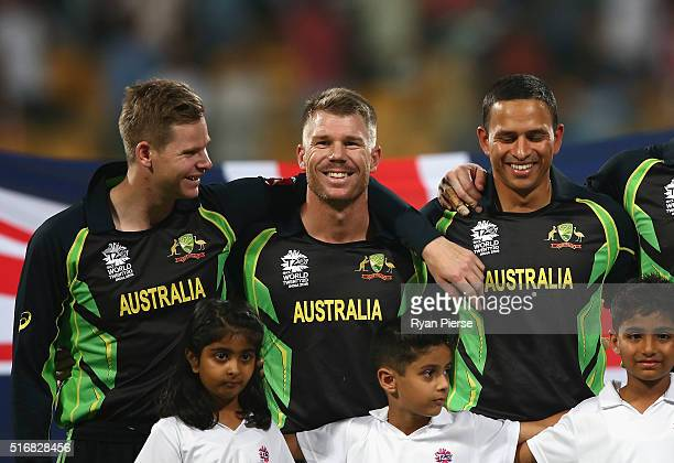 Steve Smith David Warner and Usman Khawaja of Australia look on during the anthems during the ICC World Twenty20 India 2016 Super 10s Group 2 match...