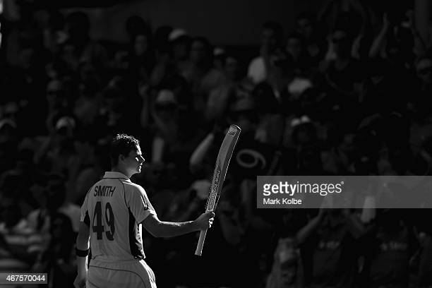 Steve Smith of Australia acknowledges the crowd as he leaves the field after being dismissed for 105 during the 2015 Cricket World Cup Semi Final...