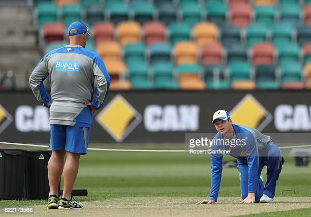Steve Smith of Australia and Darren Lehmann coach of Australia check the pitch during the Australian nets session at Blundstone Arena on November 11...