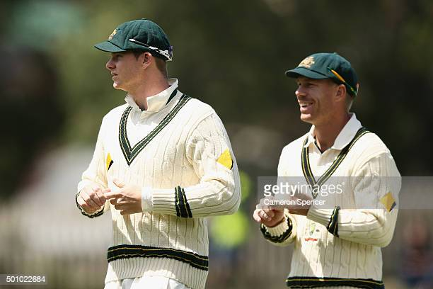 Steve Smith of Australia and David Warner of Australia leave the field at the conclusion of the match during day three of the First Test match...