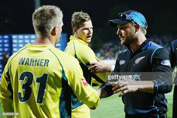 Steve Smith of Australia and David Warner of Australia shake hands with Brendon McCullum of the Black Caps after losing the 3rd One Day International...