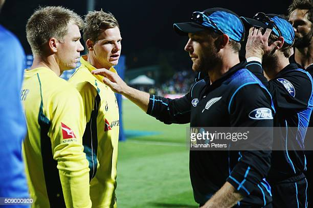 Steve Smith of Australia and David Warner of Australia speaks with Brendon McCullum of the Black Caps after losing the 3rd One Day International...