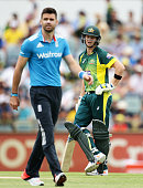 Steve Smith of Australia and James Anderson of England have a discussion after a delivery during the final match of the Carlton Mid One Day...