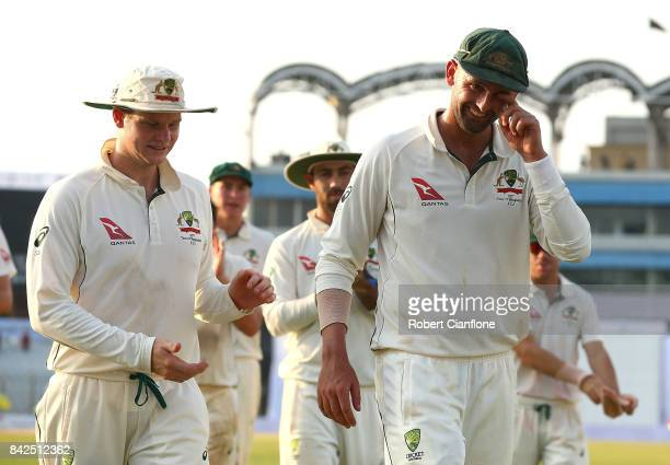 Steve Smith of Australia and Nathan Lyon walk off the field at the end of play during day one of the Second Test match between Bangladesh and...