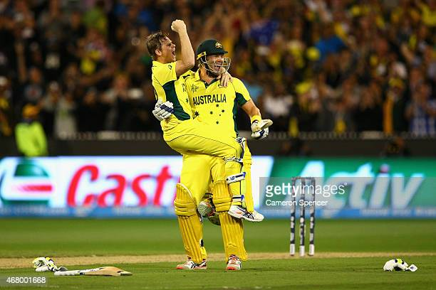 Steve Smith of Australia and team mate Shane Watson of Australia celebrate winning the 2015 ICC Cricket World Cup final match between Australia and...