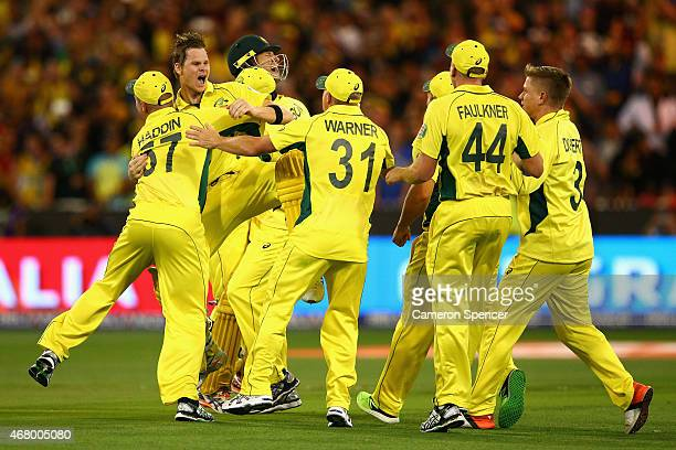 Steve Smith of Australia and team mates celebrate winning the 2015 ICC Cricket World Cup final match between Australia and New Zealand at Melbourne...