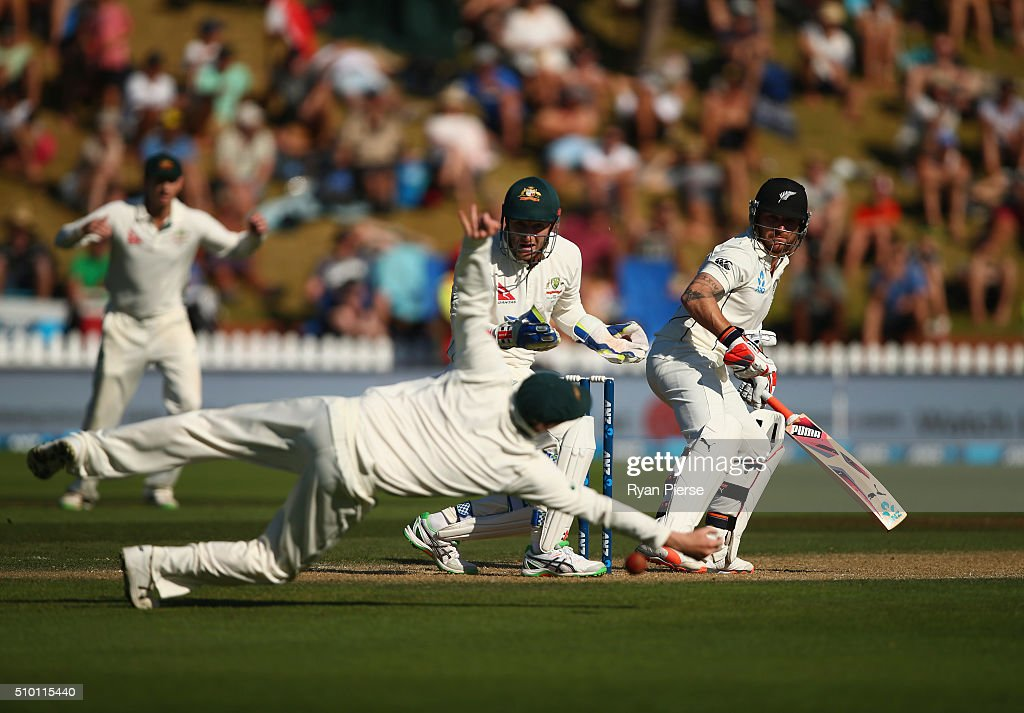 Steve Smith of Australia attempts to catch <a gi-track='captionPersonalityLinkClicked' href=/galleries/search?phrase=Brendon+McCullum&family=editorial&specificpeople=208154 ng-click='$event.stopPropagation()'>Brendon McCullum</a> of New Zealand during day three of the Test match between New Zealand and Australia at Basin Reserve on February 14, 2016 in Wellington, New Zealand.