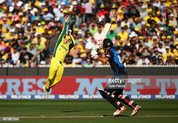 Steve Smith of Australia attempts to catch Grant Elliott of New Zealand during the 2015 ICC Cricket World Cup final match between Australia and New...