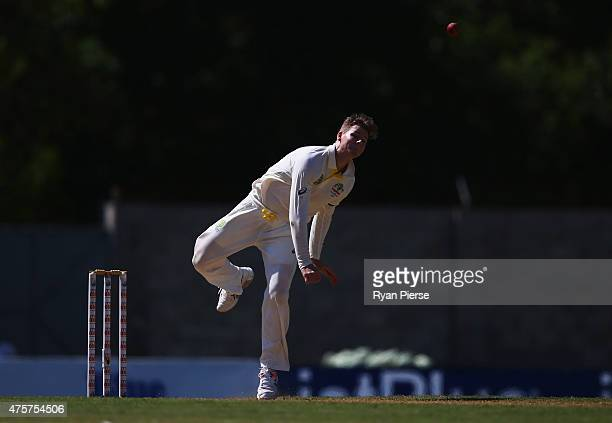 Steve Smith of Australia bowls during day one of the First Test match between Australia and the West Indies at Windsor Park on June 3 2015 in Roseau...