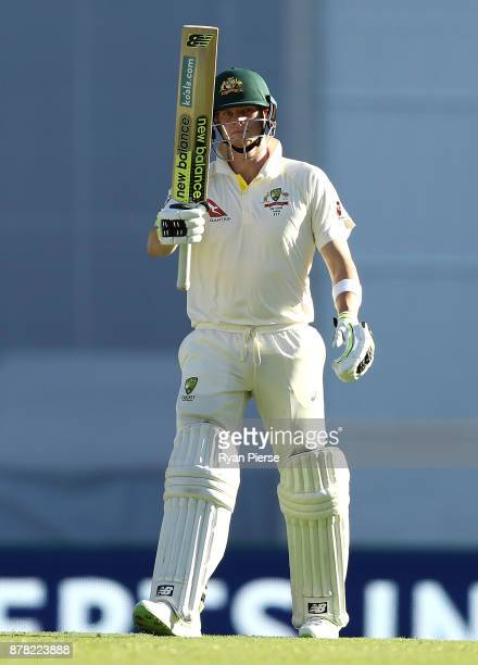 Steve Smith of Australia celebrates after reaching his half century during day two of the First Test Match of the 2017/18 Ashes Series between...