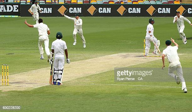 Steve Smith of Australia celebrates after running out Yasir Shah of Pakistan to claim victory during day five of the First Test match between...