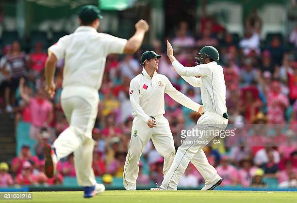 Steve Smith of Australia celebrates after taking a catch to dismiss Asad Shafiq of Pakistan off the bowling Steve O'Keefe of Australia of during day...