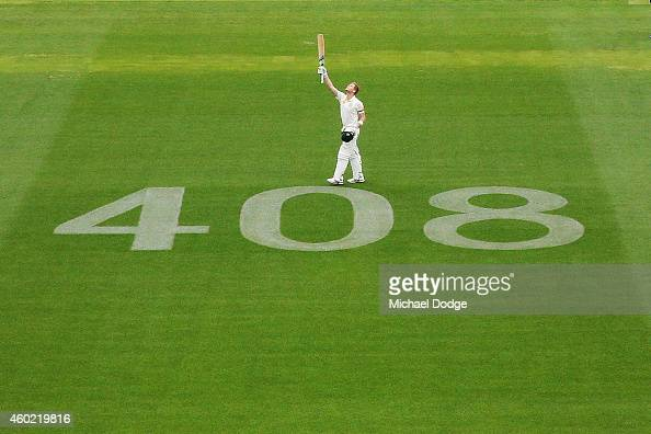 Steve Smith of Australia celebrates his century next to the number 408 displayed as a tribute to the late Phillip Hughes who was the 408th test...