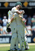 Steve Smith of Australia celebrates scoring a century with teram mate Mitchell Johnson during day three of the 2nd Test match between Australia and...