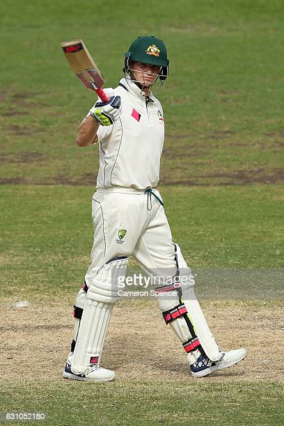 Steve Smith of Australia celebrates scoring a half century during day four of the Third Test match between Australia and Pakistan at Sydney Cricket...