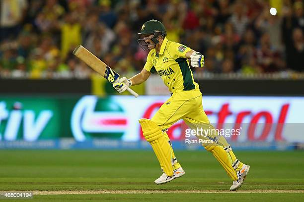 Steve Smith of Australia celebrates victory after hitting the winning runs during the 2015 ICC Cricket World Cup final match between Australia and...